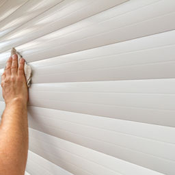 a man's hand wiping the garage door